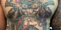 samurai mask and snake tattoo on chest